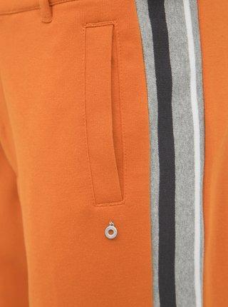 Oranžové tepláky s pásom Kari Traa Bjorgum