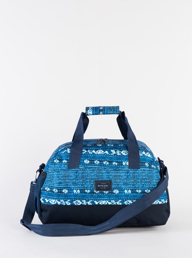 Modrá vzorovaná cestovná taška Rip Curl